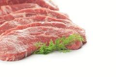 Os cortes de carne frescos/isolaram-se no branco Fotografia de Stock