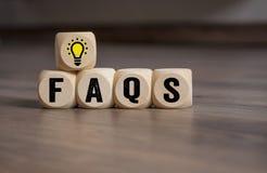 Os cubos cortam com ampola e FAQ fotos de stock royalty free