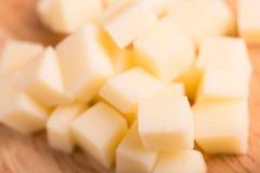 Os cubos do queijo fecham-se acima Fotos de Stock Royalty Free