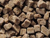 Os cubos Rushy do açúcar cru fecham-se acima Imagem de Stock Royalty Free
