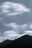 Os cumes da montanha na noite Fotos de Stock Royalty Free