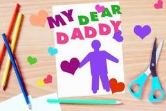 Os cumprimentos das crianças com dia de pais Imagens de Stock Royalty Free
