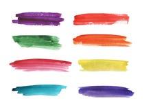 Os cursos pintados à mão da escova da aguarela colorida são isolados em um fundo branco imagem de stock