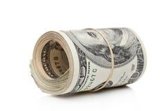 Os dólares americanos Rolaram acima e apertaram com faixa imagens de stock royalty free