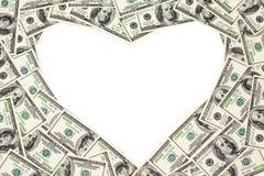 Os dólares moldam como o coração Fotografia de Stock Royalty Free