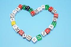 Os dados arranjaram na forma do coração do amor Foto de Stock Royalty Free