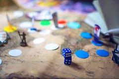 Os dados estão nos jogos de mesa da fantasia do fundo Foto de Stock Royalty Free
