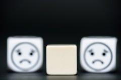 Os dados vazios com emoticon cortam (triste) no fundo Fotos de Stock Royalty Free
