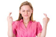 Os dedos cruzaram-se, pensamento ansioso, branco isolado Foto de Stock