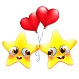 os desenhos animados protagonizam no amor com balões do coração Imagens de Stock Royalty Free