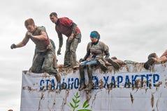 Os desportistas saltam na água Caráter de aço Tyumen Fotos de Stock Royalty Free