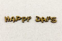 Os dias felizes aqui comemoram outra vez para apreciar o tipo da tipografia fotos de stock royalty free