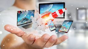 Os dispositivos de conexão da tecnologia do homem de negócios e o foguete startup 3D rendem Imagem de Stock