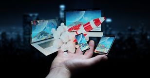 Os dispositivos de conexão da tecnologia do homem de negócios e o foguete startup 3D rendem Foto de Stock Royalty Free