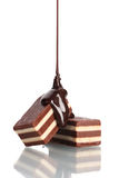 Os doces de ?hocolate derramaram o chocolate Imagem de Stock
