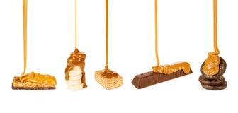 os doces e as cookies derramaram o caramelo Imagem de Stock Royalty Free