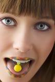 Os doces na lingüeta Fotos de Stock Royalty Free