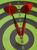 Os dois dardos vermelhos que batem o bullseye Imagem de Stock