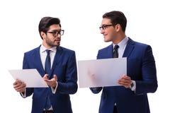 Os dois homens de negócios com as tabuletas virtuais isoladas no branco Imagem de Stock