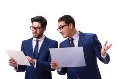 Os dois homens de negócios com as tabuletas virtuais isoladas no branco Imagem de Stock Royalty Free