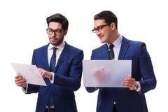 Os dois homens de negócios com as tabuletas virtuais isoladas no branco Foto de Stock