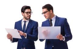 Os dois homens de negócios com as tabuletas virtuais isoladas no branco Fotos de Stock Royalty Free