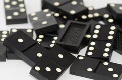 Os dominós dos dados afrouxam imagem de stock