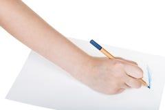 Os esboços da mão por de madeira corrigem no papel Foto de Stock