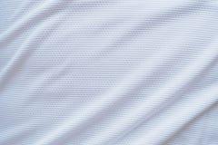 Os esportes brancos da textura da tela da roupa do jérsei do futebol vestem Fotografia de Stock