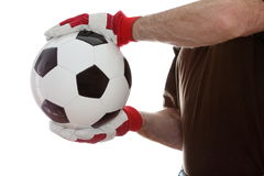 Os esportes equipam estão tomando uma bola de futebol imagem de stock royalty free