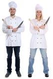 Os estagiários do estagiário do aprendiz do cozinheiro cozinham o cookin completo ereto do corpo foto de stock royalty free