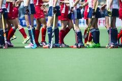 Os EUA batem Inglaterra durante o campeonato do mundo 2014 do hóquei Fotografia de Stock Royalty Free