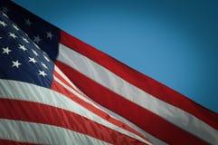 Os EUA embandeiram no fundo azul Foto de Stock Royalty Free