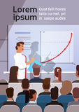 Os executivos agrupam em cursos de formação Flip Chart da reunião da conferência com gráfico Imagem de Stock Royalty Free