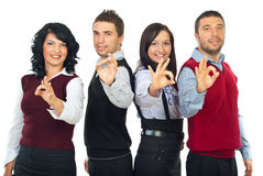 Os executivos agrupam mostrar o sinal aprovado Foto de Stock Royalty Free