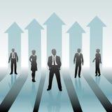 Os executivos da equipe movem sobre setas Imagens de Stock Royalty Free
