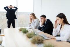 Os executivos infelizes e tristes de perdem Imagens de Stock