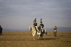 Os fãs da história em trajes militares reenacts a batalha de três imperadores Foto de Stock Royalty Free