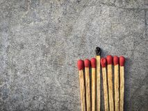Os fósforos queimados com os fósforos novos Imagens de Stock