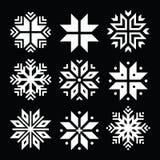 Os flocos de neve, ícones brancos do Natal ajustaram-se no preto Imagens de Stock Royalty Free