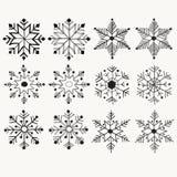 Os flocos de neve ajustaram-se com desenhado à mão, vetor da garatuja para o Natal Imagem de Stock