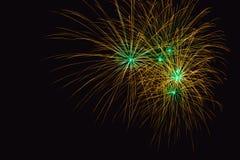 Os fogos-de-artifício abstraem no fundo escuro Imagem de Stock
