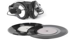Os fones de ouvido arranjaram sobre uns 45 RPM velhos - imagem conservada em estoque Imagem de Stock Royalty Free