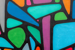 Os grafittis coloridos da arte bonita abstrata da rua denominam o close up Cultura urbana icónica moderna da juventude detalhe Po Foto de Stock