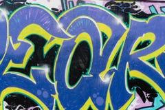 Os grafittis coloridos da arte bonita abstrata da rua denominam o close up Detalhe de uma parede Pode ser ?til para fundos Ic?nic fotografia de stock