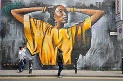 Os grafittis famosos trabalham nas ruas de Londres, Inglaterra Imagem de Stock Royalty Free