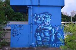 Os grafittis projetam em uma parede, fundos urbanos Imagens de Stock Royalty Free