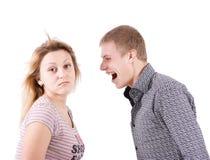Os gritos do homem na mulher Fotografia de Stock Royalty Free
