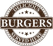 Os hamburgueres deliciosos servidos aqui carimbam ilustração stock