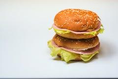 Os hamburgueres no fundo branco Imagens de Stock
